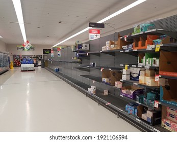 Meadowbrook, Queensland Australia - March 6 2020: An almost empty row of tissue shelves with only a few items of facial tissues left  in a Woolworths Supermarket