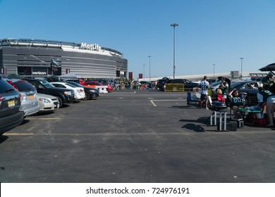 Meadowlands, New Jersey - Circa 2017: New York Jets fans tailgate in the parking lot outside Metlife Stadium before american football game during a sunny day