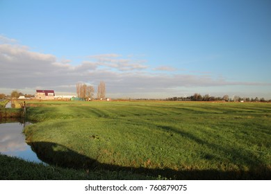 Meadows with blue sky and clouds in the lowest area of western europe : the Zuidplaspolder in Netherlands