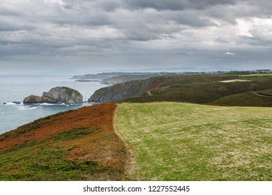 Meadows, cliffs and Cantabrian Sea from Cabo de Peñas. Protected landscape. Asturias.