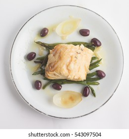 Meal of Boiled Cod Fish with black olives and green beans