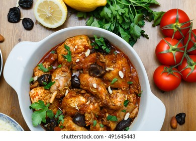A meal of chicken tagine stew in a spicy, nutty tomato sauce and prunes