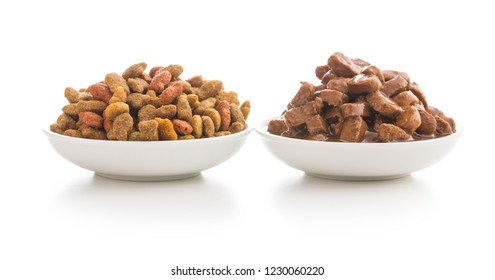 Meal for dog or cat. Canned meat with sauce and dry kibble food isolated on white background.