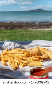 A Meal of Fish and Chips at the Beach in Takapuna, Auckland New Zealand with Rangitoto in the Background