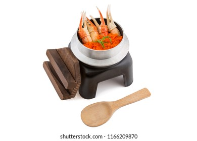Meal of Japanese crab, kani ebiko in the iron cooking pot, traditional Japanese rice dish cooked in an iron pot called a Kamameshi isolated on white background