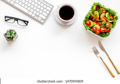 meal in lunch box and coffee for dinner on white office desk background with keyboard top view mockup