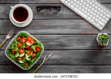 meal in lunch box and coffee for dinner on wooden office desk background with keyboard top view mockup