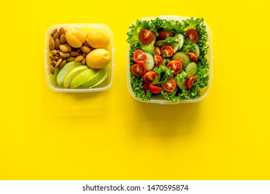 meal in lunch box to take away on yellow background top view mockup