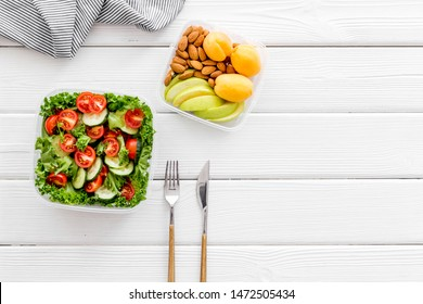 meal in lunch box to take away on white wooden background top view mockup