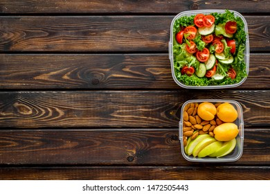 meal in lunch box to take away on wooden background top view mockup