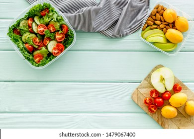 meal in lunch box to take away on mint green wooden background top view mockup