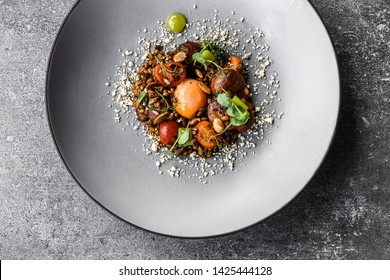 meal meat food fine cuisine beef elegant black modern restaurant table top view decoration chef gourmet dinner tasty delicious diet