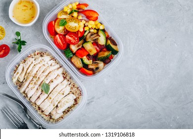 Meal prep lunch box containers with quinoa, grilled and fresh vegetables and chicken