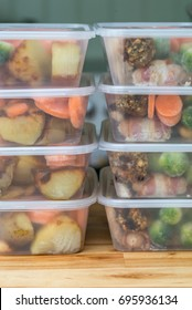 Meal prep. Stack of home cooked roast chicken dinners in containers ready to be frozen for later use. Vertical.