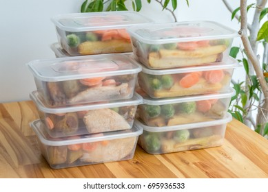 Meal prep. Stack of home cooked roast chicken dinners in containers ready to be frozen for later use.