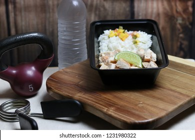 Meal prepped meal of chicken and rice with salsa for clean eating