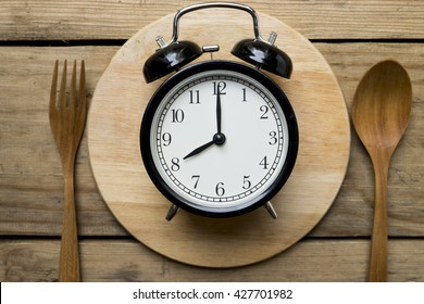 Meal time with alarm clock, breakfast