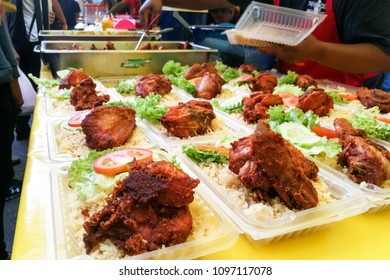 Meals comprising rice and chicken being retailed at market stall at bazaar in Malaysia during Ramadan month for iftar.