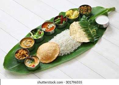 Indian Restaurant Serving Food On Banana Leaf