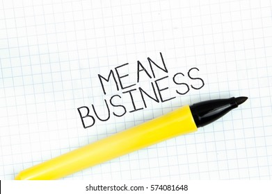 MEAN BUSINESS concept write text on notebook