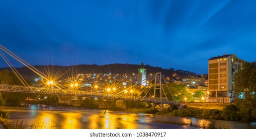 Mean dusk over Little Bridge and the Clock Tower in Veles, Macedonia, reflected on the surface of river Vardar.