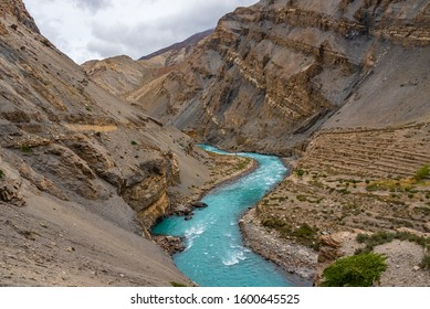 Meander is one of a series of regular sinuous curves in a river, produced by river as it erodes the sediments from outer concave cut bank and deposits sediment downstream on an inner convex bank.