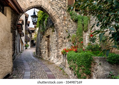 Meander street with the antique lamp in the old village Saint-Saphorin, Canton Vaud, Switzerland