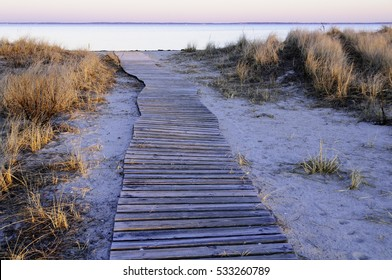 Meandering boardwalk to beach reveals views of Buzzards Bay and Cape Cod
