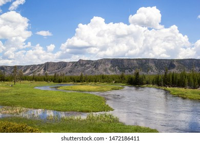 Meandering River through the Yellowstone National Park valley with lush grassland