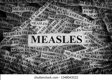 Measles. Torn pieces of paper with the words Measles. Concept image. Black and White. Close up.
