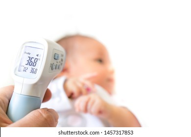 Measure baby's fever with digital fever meter. sick baby with high fever