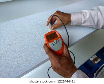 Measure Dry Film Thickness (DFT) for fireproof painting on steel structure.