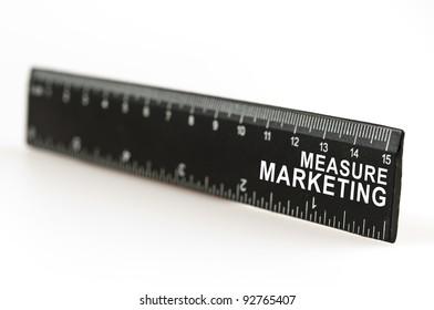 Measure marketing on black ruler