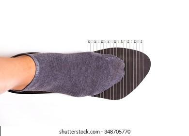 measure shoe size on white background