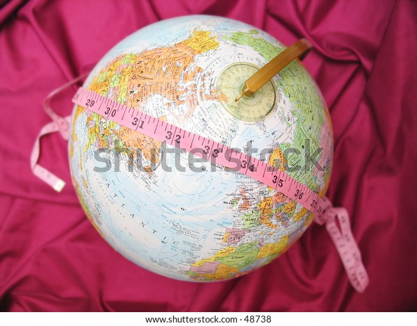 Measure tape over a globe.