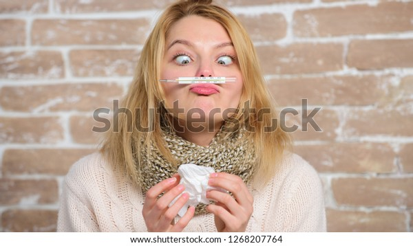Measure temperature. Break fever remedies. High temperature concept. How to bring fever down. Woman feels badly ill. Sick girl with fever. Fever symptoms and causes. Girl hold thermometer and tissue.