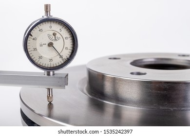 Measurement accuracy of brake discs for passenger cars. Measurements with high accuracy in the laboratory. Light background.