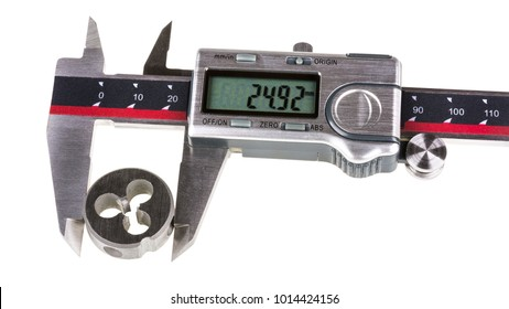 Measurement a diameter of thread cutting die by digital calipers. Stainless steel gauging tool with green display when measuring the metal part. Isolated on white background.
