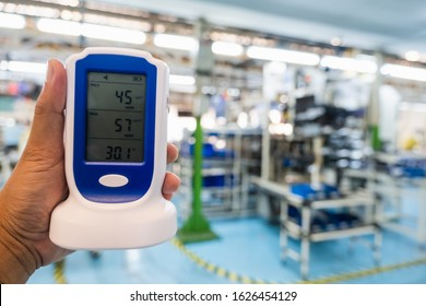 Measurement dust PM 2.5 measure In office Exceed the standard pollution environment in the work Safety alert Inventory Bangkok Thailand