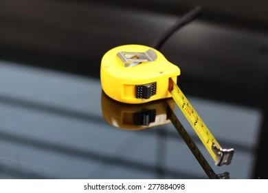 measurement tape on black background