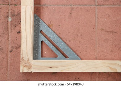 Measuring angle of wooden structure for making furniture