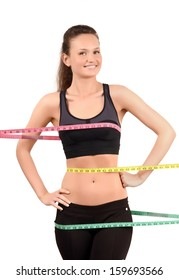 Measuring bust, waist, hips. Beautiful happy fit girl wrapped with three measuring tapes in inch. Isolated on white.
