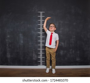 Measuring child before school. Time to go back to school