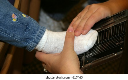 measuring a child's foot for shoe size