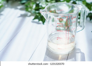 Measuring cup on wooden board