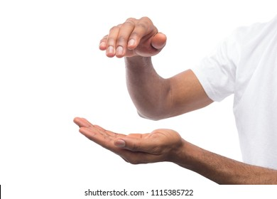 Measuring growth. Outstretched african-american male hand, man keeping empty palm on white isolated background