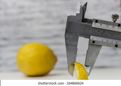Measuring a lemon slice with a Vernier Caliper / Perfectionism