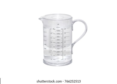 Measuring plastic jug full of water isolated