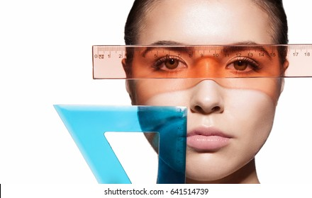Measuring the proportions of a woman's face with instruments before a plastic operation. Isolated on white background
