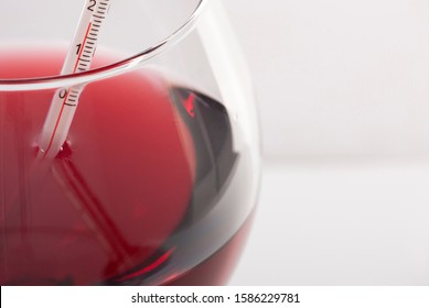 Measuring Red Wine Temperature with a Wine Thermometer. Close-up